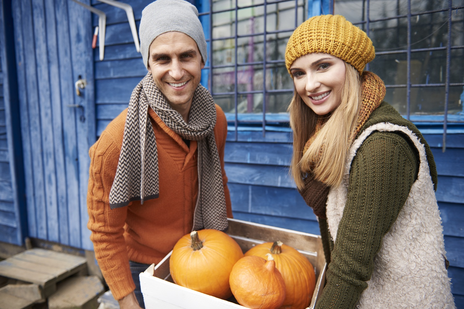 Happy couple with organic pumpkins