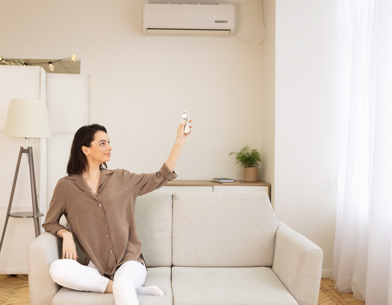 woman switching air con temperature