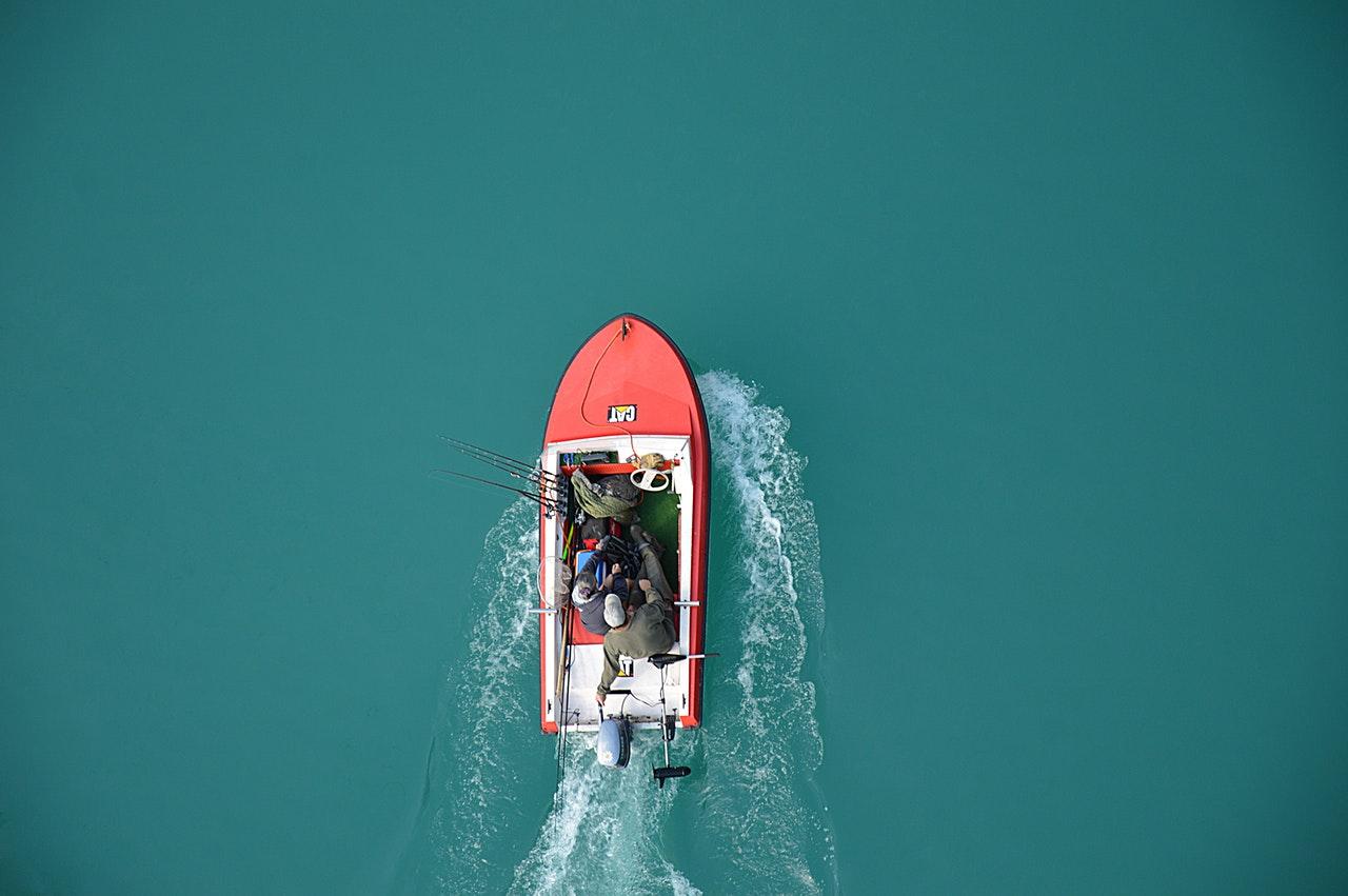 boat and fishermen fishing