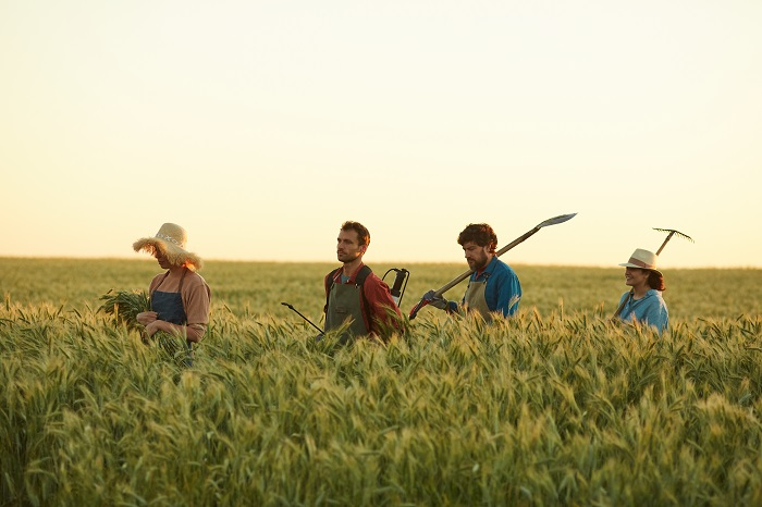 farmers holding their farm tools